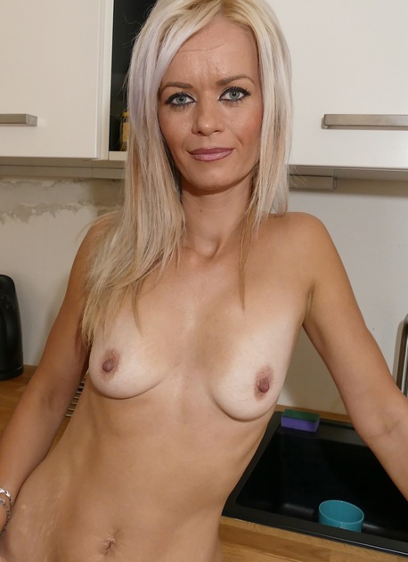 Older housewife Anny B exposes her naked tanlined body.