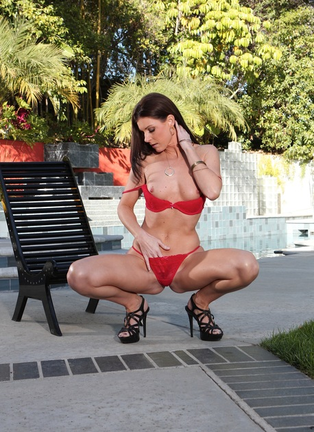 Brunette MILF India Summer strips naked outdoors.