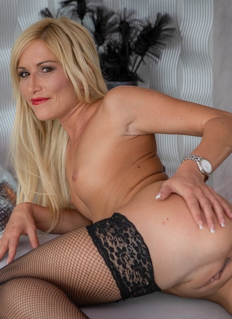Stunning blonde MILF Black Blondie naked in only black stockings.