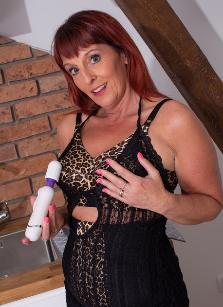 Horny older woman Beau Diamonds uses vibrator on her mature pussy.