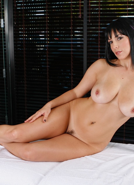 Big breasted brunette MILF Jelena Jensen naked on massage table.