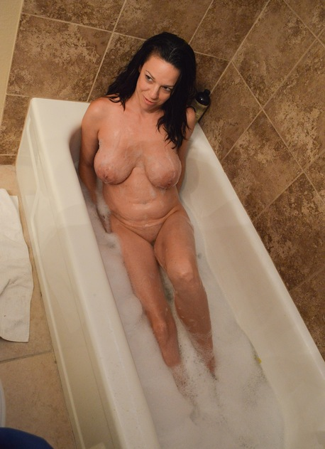 Big breasted mature amateur Candace takes a bath.